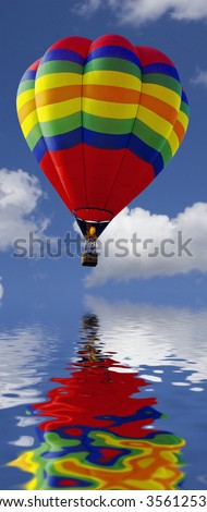 close up of a hot air balloon flying above water - stock photo