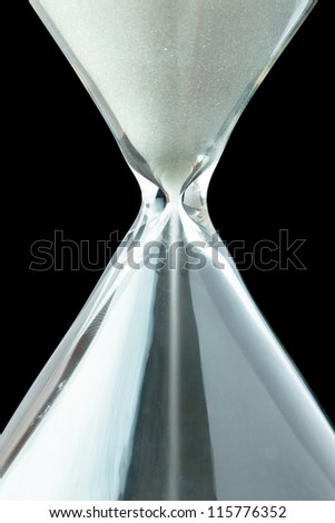 Close up of a hourglass against a black background - stock photo