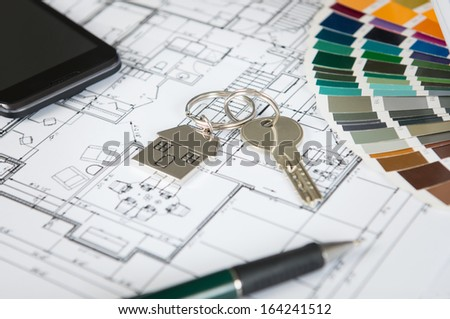 Close Up Of A House Key On Blueprint And Color Palette - stock photo
