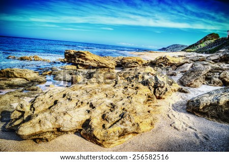 close up of a huge rock in Castelsardo shoreline. Processed for hdr tone mapping effect - stock photo