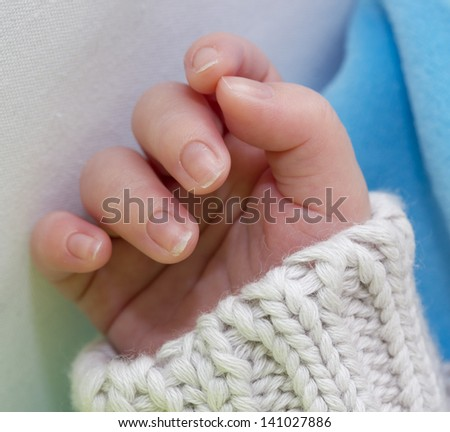 close up of a infant hand