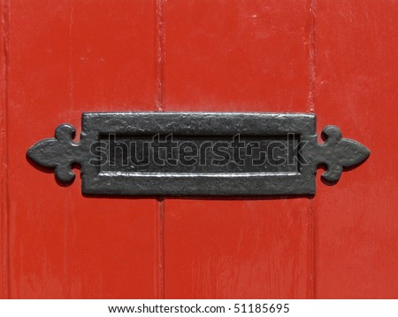 Close up of a letter box in a red door - stock photo