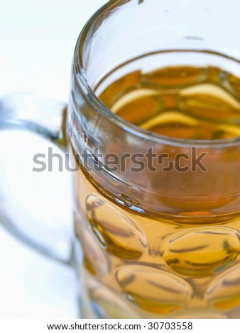 Close-up of a light beer in a big beer glass without foam - stock photo