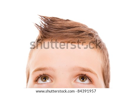 Close-up of a litle boy looking up - stock photo