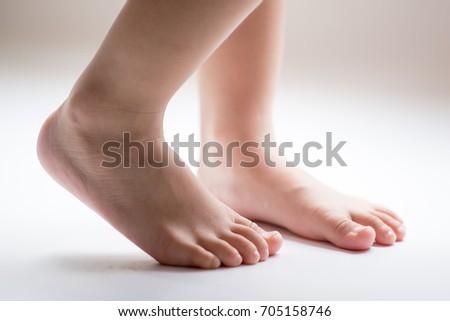 Barefoot man woman standing face each stock photo for Hardwood floors hurt feet