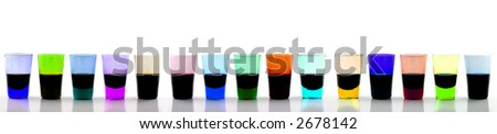 Close up of  a long line of 15 brightly colored drinking glasses
