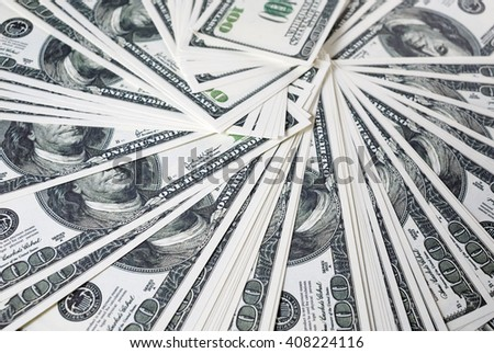 Close-up of a lot of one hundred dollar bills. Much money. A lot of money. Counterfeit money. Selective focus. - stock photo