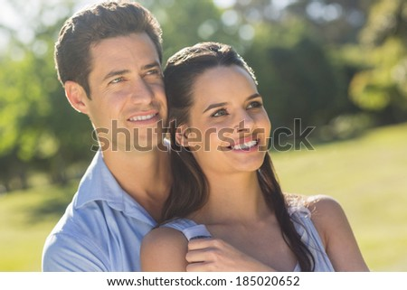 Close-up of a loving and happy couple looking away at the park