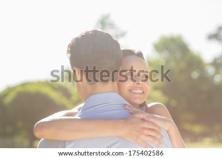 Close-up of a loving and happy woman embracing man at the park