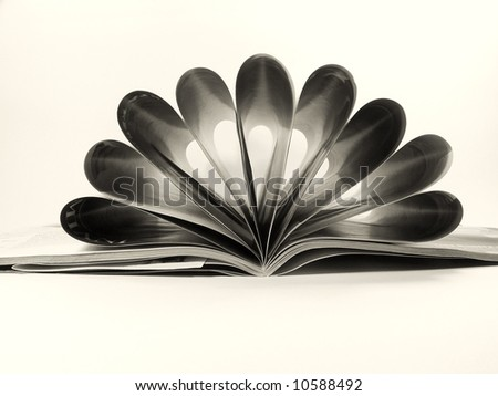 Close up of a magazine with folded pages - stock photo