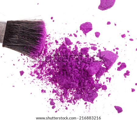 close up of a make up powder and a brush on white background