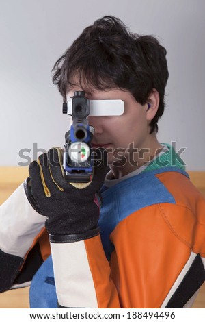 Close-up Of A Male Athlete Doing Target Practice - stock photo