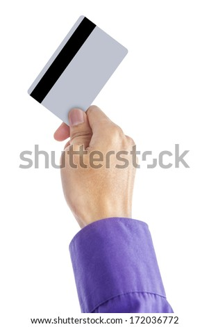 Close up of a male hand holding up a credit card - stock photo
