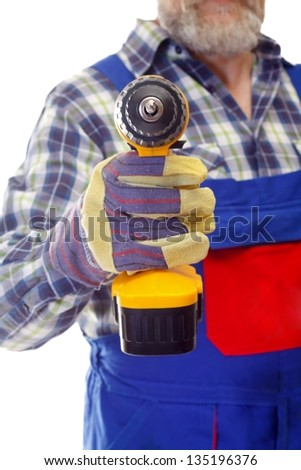 Close-up of a man holding drill on isolated background - stock photo