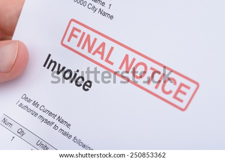 Close-up Of A Man Holding Invoice With Final Notice Stamp On It - stock photo