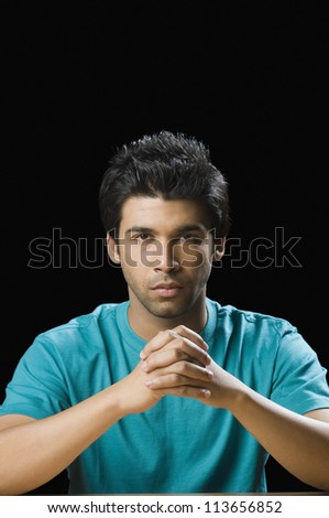 Close-up of a man looking serious - stock photo