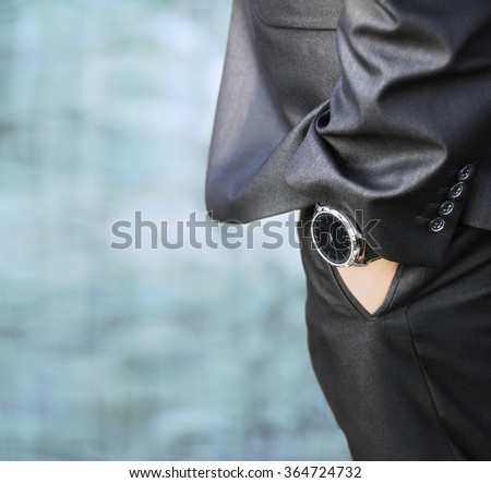 Close up of a man's hand wearing a watch - stock photo