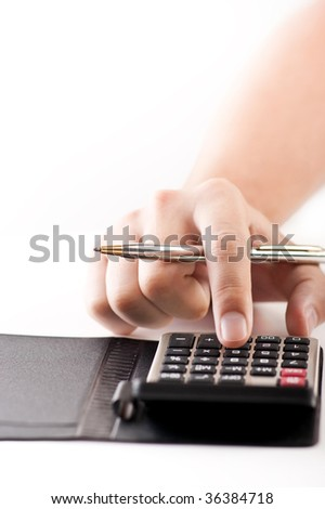 Close-up of a man's hand with pen using calculator on a white background - stock photo