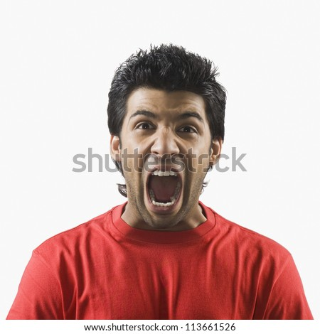 Close-up of a man screaming - stock photo