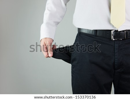 Close-up of a man showing empty pocket - stock photo