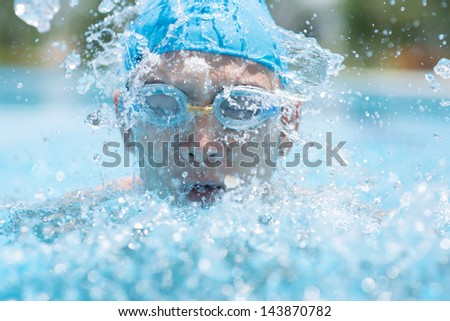 Close-up of a man swimming in the swimming-pool - stock photo