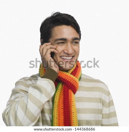 Close-up of a man talking on a mobile phone - stock photo