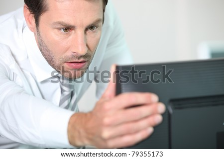 close-up of a man with computer
