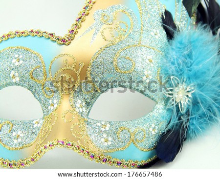 Close up of a Mardi Gras mask with jewels isolated on white background. - stock photo