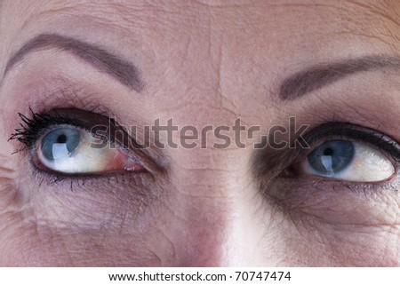 Close-up of a mature woman eyes - stock photo