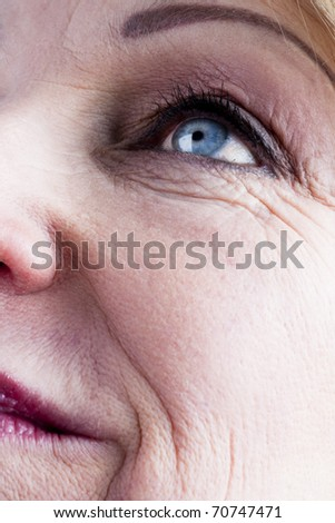 Close-up of a mature woman face - stock photo