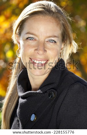 Close-up Of A Mature Woman Smiling At The Camera. She is confident and a really good mother. - stock photo