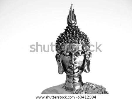 Close up of a metalic Budha on a white back - stock photo