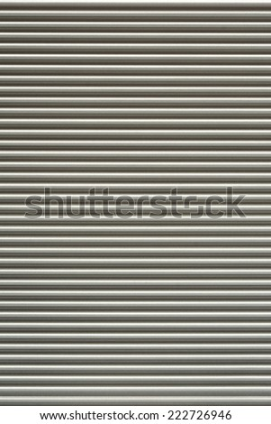 Close up of a metallic corrugated background - stock photo