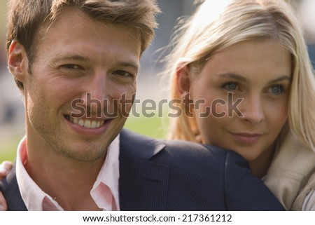 Close-up of a mid adult couple smiling - stock photo