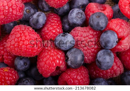 Close up of a mixture of raspberries and blueberries.