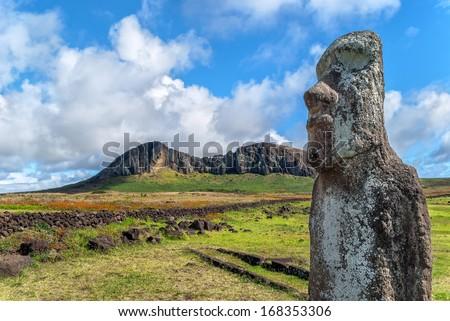 Close-up of a moai at Ahu Tongariki with the quarry of Rano Raraku in the background, Easter Island (Rapa Nui), Chile - stock photo