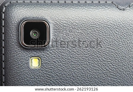 Close-up of a mobile phone camera - stock photo