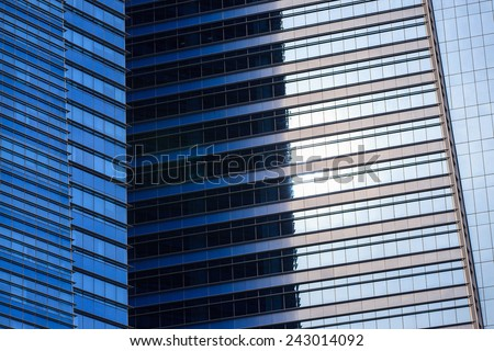 Close up of a modern blue glass building