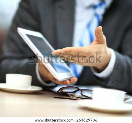 Close-up of a modern business team using tablet computer to work - stock photo