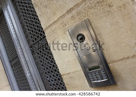 Close up of a modern intercom on a stone facade of a French house - stock photo