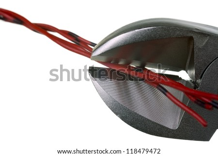 Close up of a modern nippers and a cable, isolated on white background