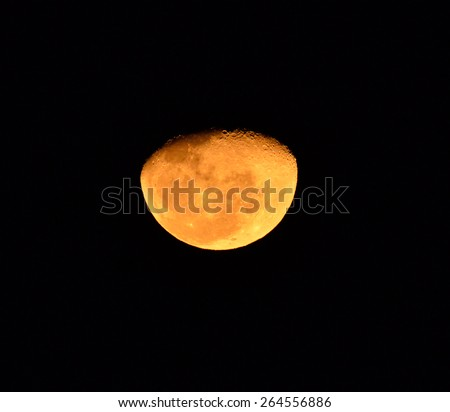 Close up of a  moon in March 2015 against a black background - stock photo