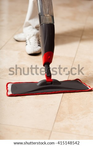 Close up of a mop cleaning tile floors