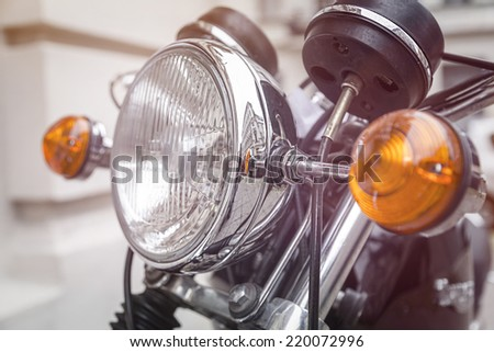 close up of a motorcycle headlight with blinker light - stock photo