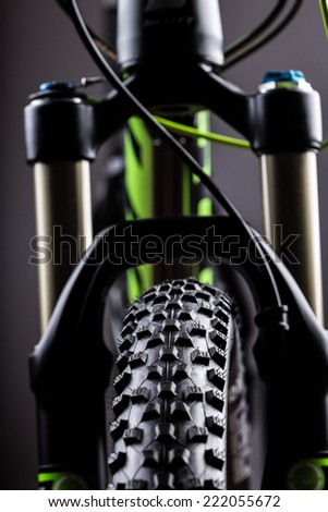 close-up of a mountain bike spring fork, studio shot.