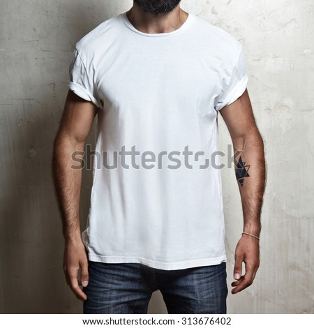 Close-up of a muscular man wearing white blank t-shirt - stock photo