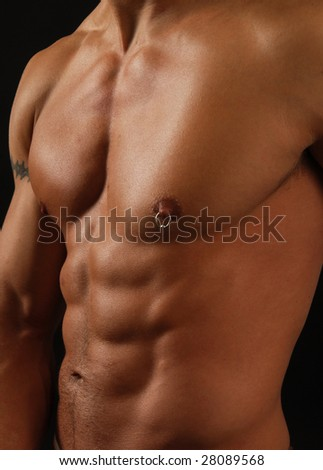 Close up of a muscular tan male torso - stock photo