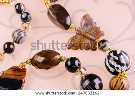 Close up of a necklace with a butterfly - stock photo