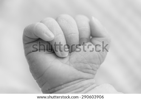 Close-up of a newborn's hand, 5 days old baby. - stock photo