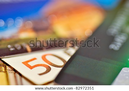 Close up of a number 50 on the fifty Euro banknote between two credit cards - stock photo